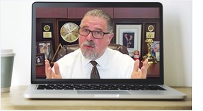 Cal Banyan on Laptop Announcing to Conduct Hypnosis Sessions Online
